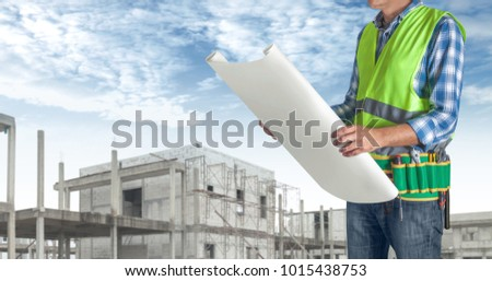 Worker man all tools supplies holding stock photo royalty free a worker man with all of tools supplies holding construction plan blueprint ready for check and malvernweather Image collections