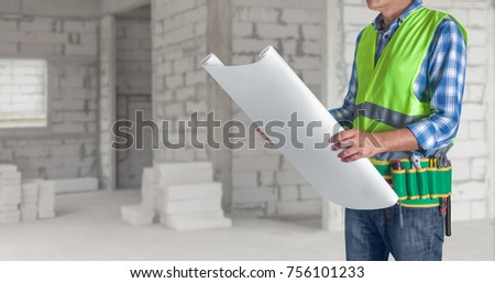 Worker man all tools supplies holding stock photo 756101233 a worker man with all of tools supplies holding construction plan blueprint ready for check and malvernweather Image collections