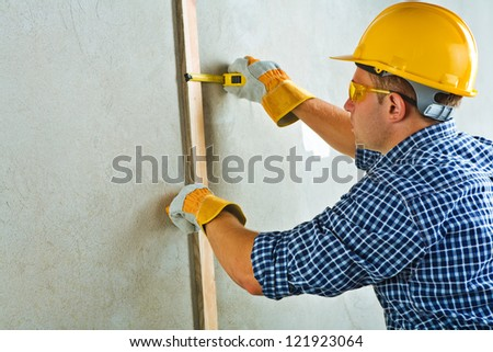 a worker measuring