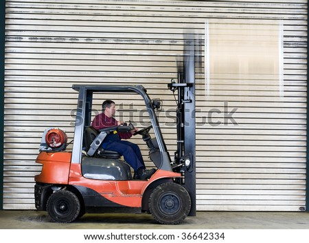 a worker transporting a box, box with motion blur - stock photo