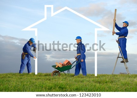 a worker who builds the house - stock photo