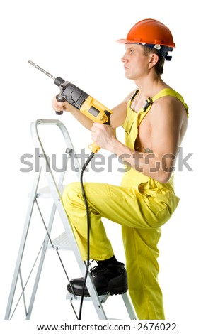 A worker with drill, isolated on white