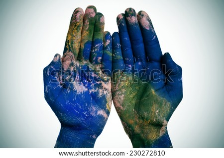 a world map in open man hands (Earth map furnished by NASA) - stock photo