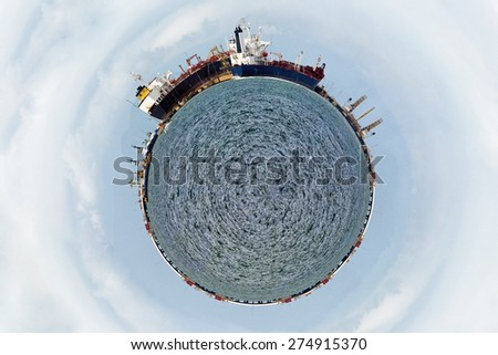 A world shape with harbor and ships - stock photo