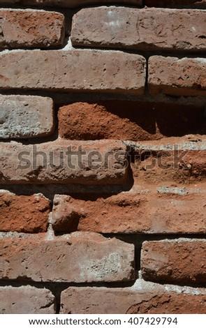 A worn brick wall texture background photo - stock photo