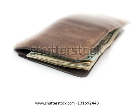 A worn leather wallet with U.S. dollars. - stock photo
