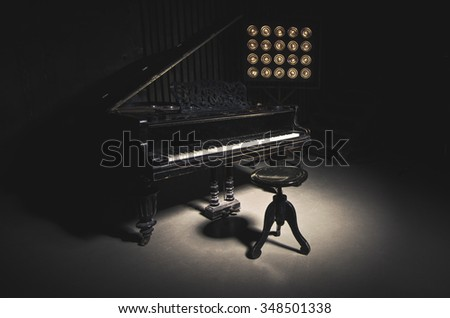 A worn piano. Photo with dark tones. - stock photo
