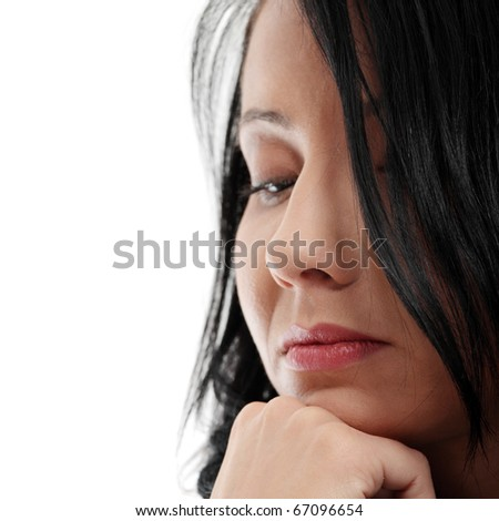 A worried and afraid young woman. Isolated on white - stock photo