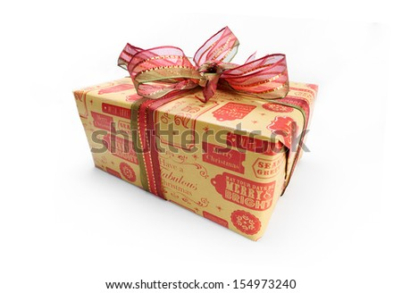 A wrapped Christmas present with a colourful ribbon bow on a white background.