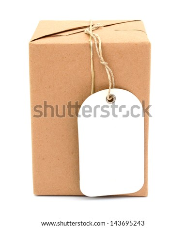 A wrapping parcel with brown paper, tied with string and with blank tag