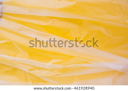 A wrinkled Plastic Bag Texture, macro, yellow background