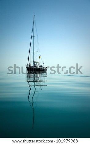 A yacht in peaceful waters - stock photo