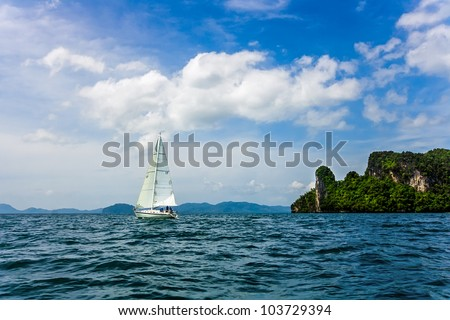 A yacht sailing in the Andaman Sea near the coast of Krabi province of Thailand - stock photo