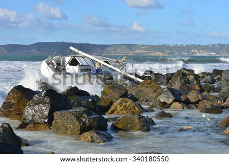 A yacht washed on a beach in San Diego during heavy sea's