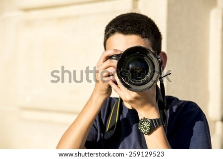 A 12 year old boy about to takea  photograph.