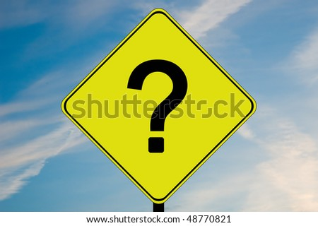 A yellow and black road sign with a question mark
