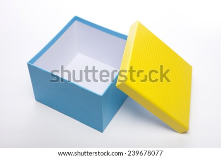 A yellow and blue(emerald green) opened empty(blank) gift box isolated white at the studio.