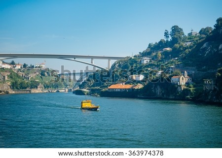 A yellow boat in Douro river. - stock photo