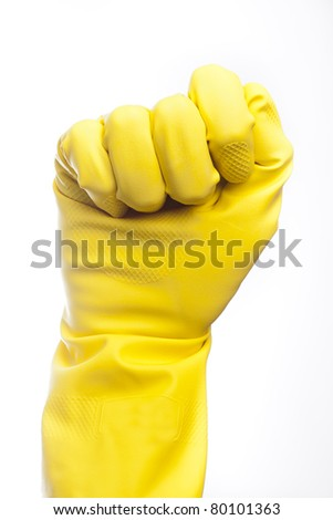 A yellow cleaning glove against a white background - stock photo