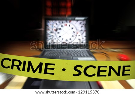 A yellow crime scene tape across a computer laptop on a table in a dimly lit room for the concept of cyber attack by anonymous hackers under investigation. - stock photo