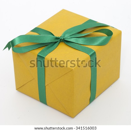 A yellow gift with a green ribbon and a bow