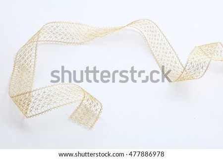 A yellow gold ribbon on a white background.