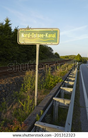 A yellow green roadsign to the Kiel Canal taken near Beldorf (Schleswig-Holstein, Germany).