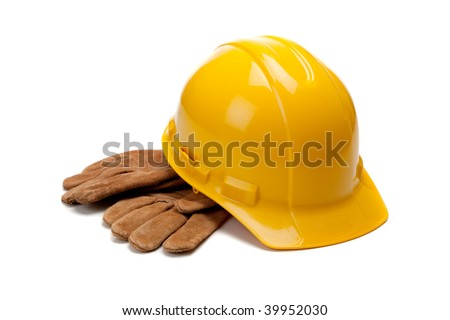 A yellow hard hat and leather work gloves on a white background - stock photo