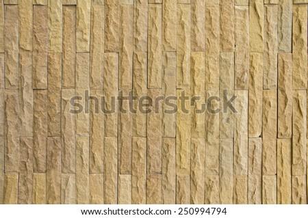 A yellow rock bricks background. - stock photo