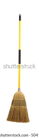 A yellow straw broom on a white background - stock photo