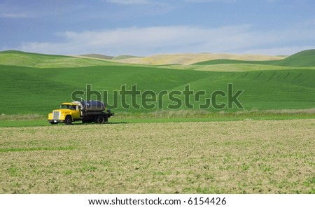 A yellow van in the fields