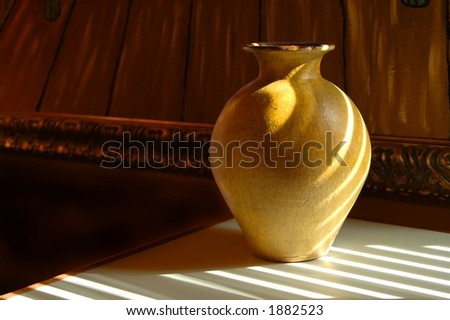 A yellow vase - stock photo