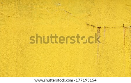 A yellow weathered concrete wall for textural background.  - stock photo