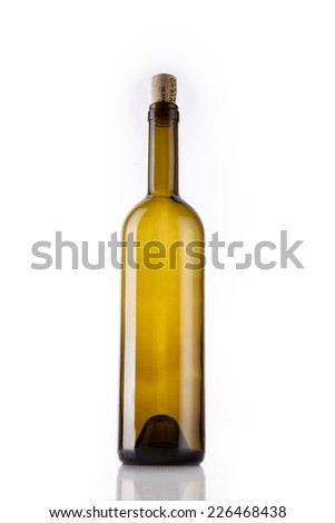 A yellow wine bottle with cork at reflective bottom isolated white - stock photo