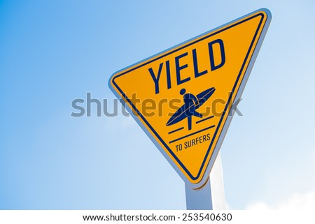 A yellow yield to surfer sign in southern California - stock photo