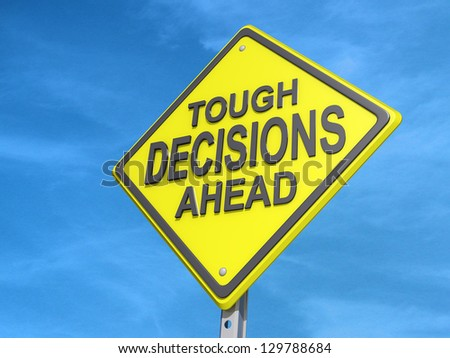 "A yield road sign with ""Tough Decisions Ahead"" with a blue sky background. - stock photo"
