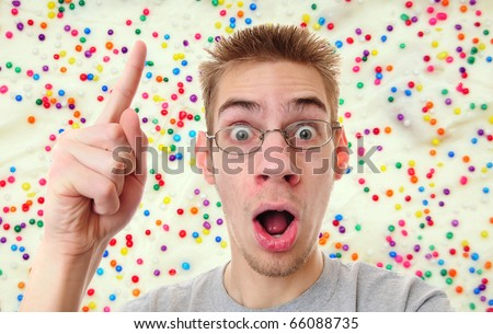 A young adult man just got surprised by his brilliant new idea. He realizes that he can bake a cake! - stock photo