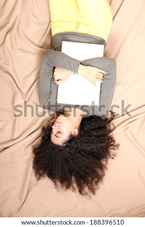 A young adult woman with a Laptop. - stock photo