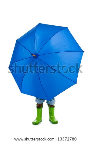 A young African American boy behind a big blue umbrella. Isolated on a white background. - stock photo