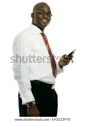A young african american businessman with a cellphone, isolated on white - stock photo