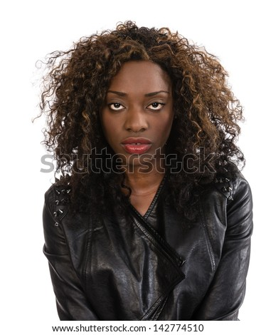 A young African American girl win a black leather jacket