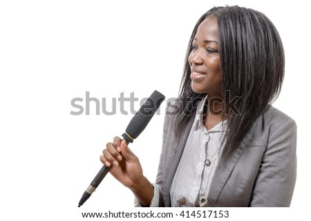 a young African american journalist with a microphone