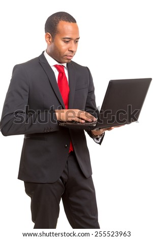A young african business man working with a laptop