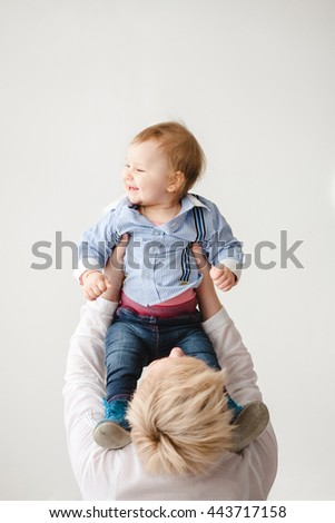 a young amazing  mother holds her son - stock photo