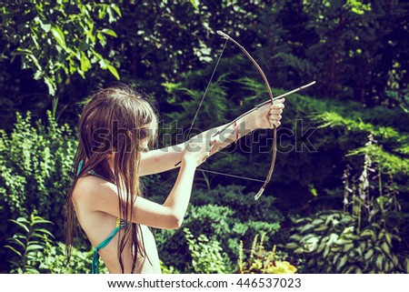 a young amazon with a bow in outdoors