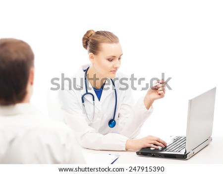 A young and attractive female doctor in white clothes is consulting a patient on a white background. - stock photo
