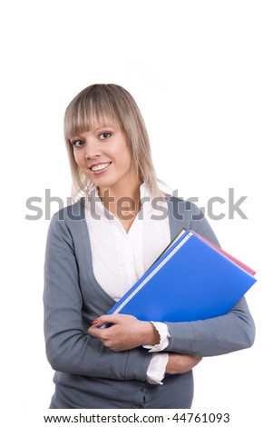 A young and beautiful schoolgirl is holding folders on white background. Senior high school student with documents.