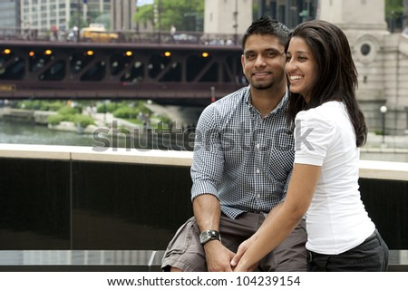 A young and happy couple on the river in Chicago downtown.