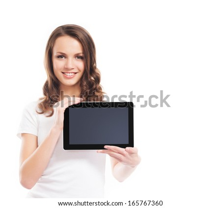 A young and happy girl holding a tablet computer isolated on a white background. - stock photo