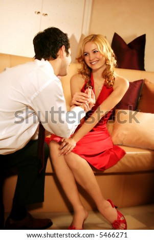 """a young and rich couple - he is asking her """"would you marry me ?"""" - stock photo"""